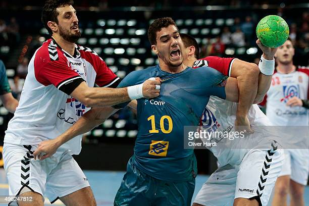 Jose Toledo of Brazil challenges for the ball with Ilija Abutovic of Serbia during the Handball Supercup between Brazil and Serbia on November 8 2015...