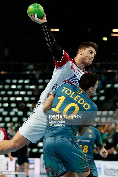 Jose Toledo of Brazil challenges for the ball with Mijajlo Marsenic of Serbia during the Handball Supercup between Brazil and Serbia on November 8...