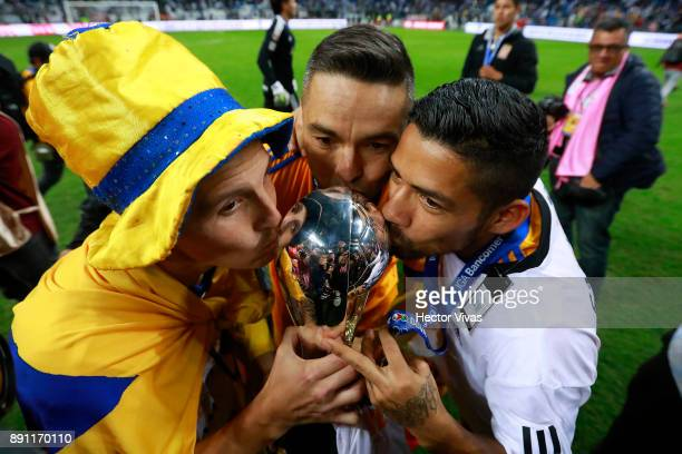 Jose Torres Juninho and Javier Aquino of Tigres kiss the trophy to celebrate after winning the second leg of the Torneo Apertura 2017 Liga MX final...