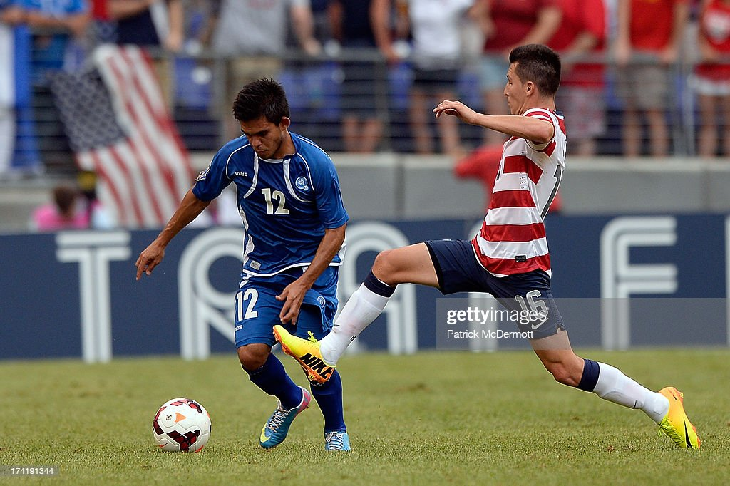 Jose Torres #16 of the United States battles for the ball against Andres Flores #12 of El Salvador during the 2013 CONCACAF Gold Cup quarterfinal game at M&T Bank Stadium on July 21, 2013 in Baltimore, Maryland.