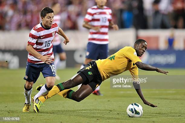 Jose Torres of the US National Team trips up JeVaughn Watson of the Jamaican National Team on September 11 2012 at Crew Stadium in Columbus Ohio