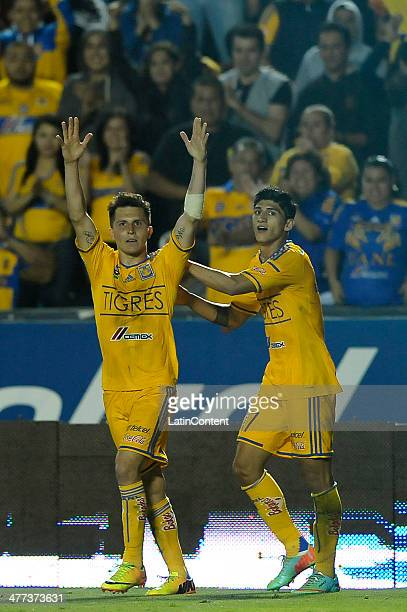 Jose Torres of Tigres celebrates after scoring along with teammate Alan Pulido during a match between Tigres UANL and Cruz Azul as part of the 10th...