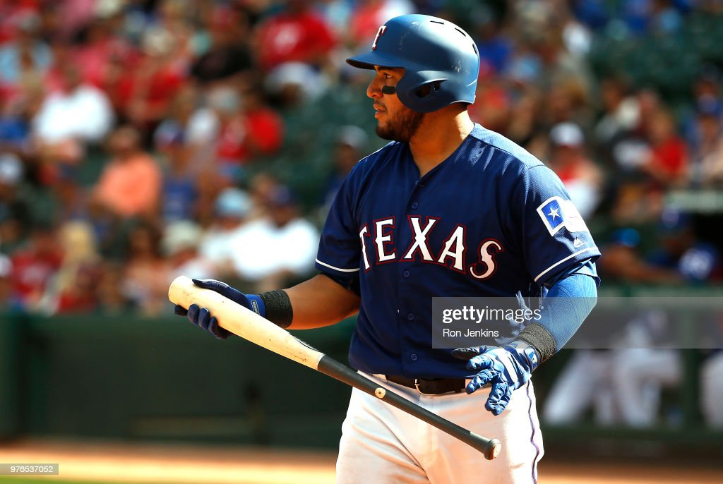 Jose Trevino #71 of the Texas Rangers looks on during an at bat against the Colorado Rockies during the eighth inning at Globe Life Park in Arlington on June 16, 2018 in Arlington, Texas. The Rangers won 5-2.