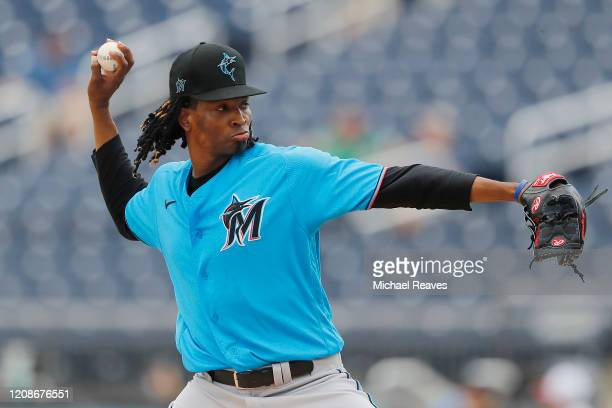 Jose Urena of of the Miami Marlins delivers a pitch against the Houston Astros in the first inning of a Grapefruit League spring training game at...