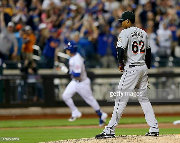 Jose Urena of the Miami Marlins reacts as Wilmer Flores of the New York Mets rounds third after he hit a two run homer in the sixth inning on April...