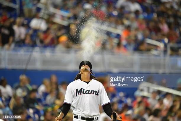 Jose Urena of the Miami Marlins sprays water on the way to the mound during the game against the Philadelphia Phillies at Marlins Park on April 14,...