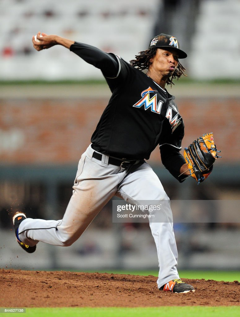 Jose Urena #62 of the Miami Marlins throws a fifth inning pitch against the Atlanta Braves at SunTrust Park on September 8, 2017 in Atlanta, Georgia.