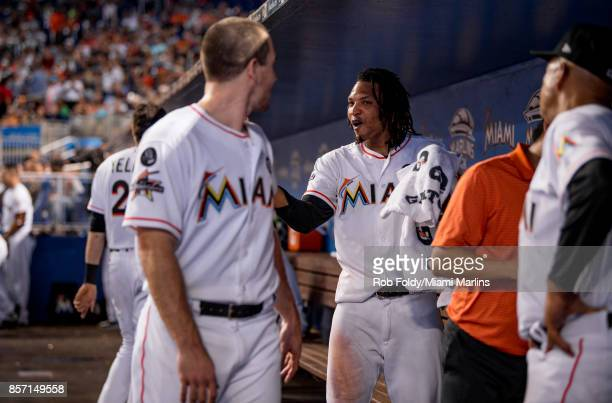 Jose Urena talks with JT Realmuto of the Miami Marlins during the game against the Atlanta Braves at Marlins Park on October 1 2017 in Miami Florida