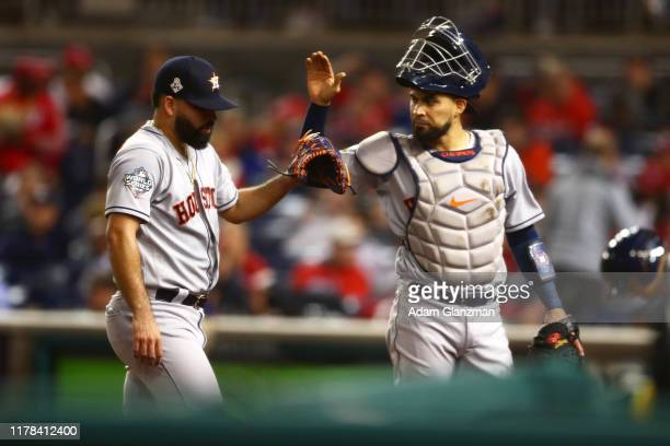 Jose Urquidy of the Houston Astros celebrates with Robinson Chirinos at the end of the second inning during Game 4 of the 2019 World Series between...