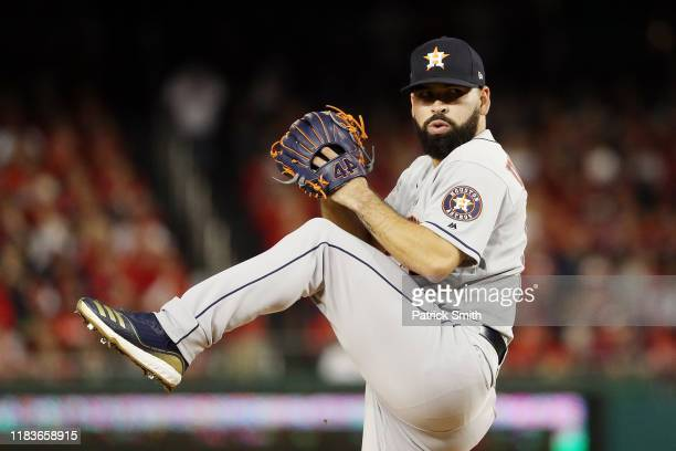 Jose Urquidy of the Houston Astros delivers the pitch against the Washington Nationals during the second inning in Game Four of the 2019 World Series...