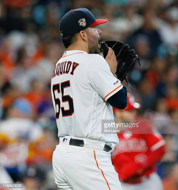 Jose Urquidy of the Houston Astros reacts to giving up a tworun home run to Shohei Ohtani of the Los Angeles Angels of Anaheim in the third inning at...