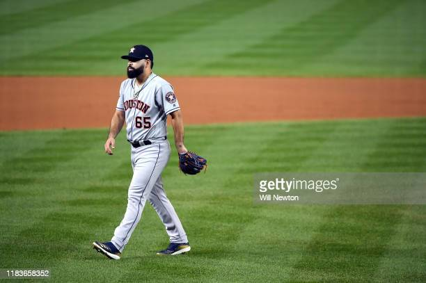 Jose Urquidy of the Houston Astros walks off the field after retiring the side in the first inning against the Washington Nationals in Game Four of...