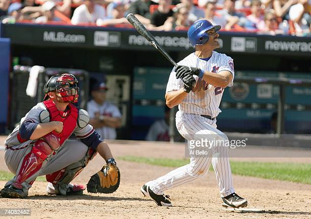 Jose Valentin of the New York Mets makes a hit against the Atlanta Braves during the game at Shea Stadium on April 22 2007 in the Flushing...