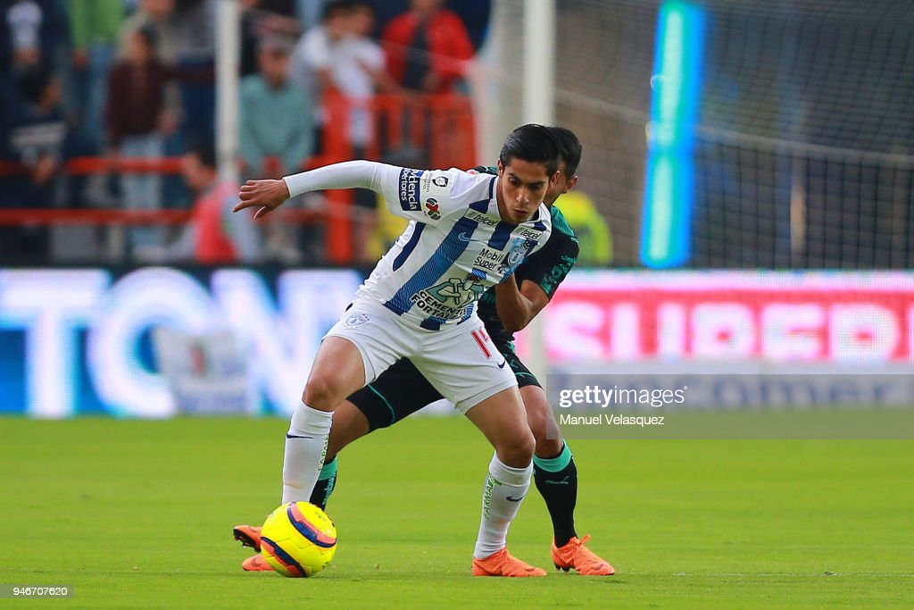 Jose Vasquez (R) of Santos struggles for the ball against Erick Aguirre (L) of Pachuca during the 15th round match between Pachuca and Santos Laguna as part of the Torneo Clausura 2018 Liga MX at Hidalgo Stadium on April 14, 2018 in Pachuca, Mexico.
