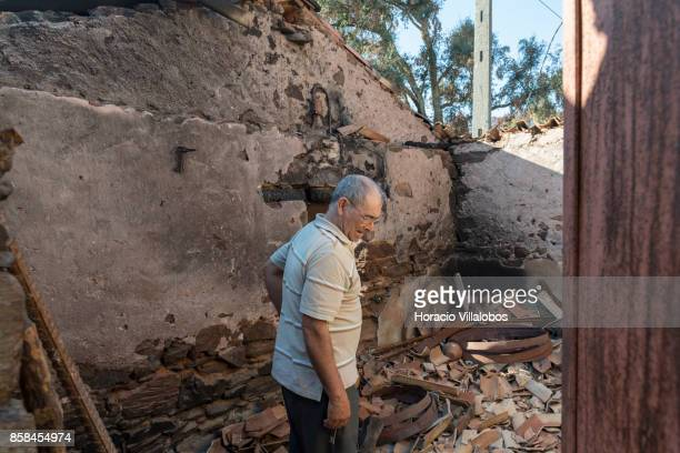 Jose Vaz da Mata is seen inside his burned barn four months after the forest fire that caused him a loss of some 15000 euros on October 06 2017 in...