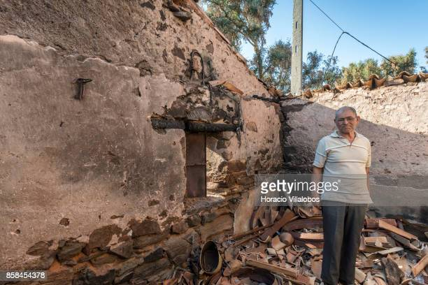 Jose Vaz da Mata stands inside his burned barn four months after the forest fire that caused him a loss of some 15000 euros on October 06 2017 in...