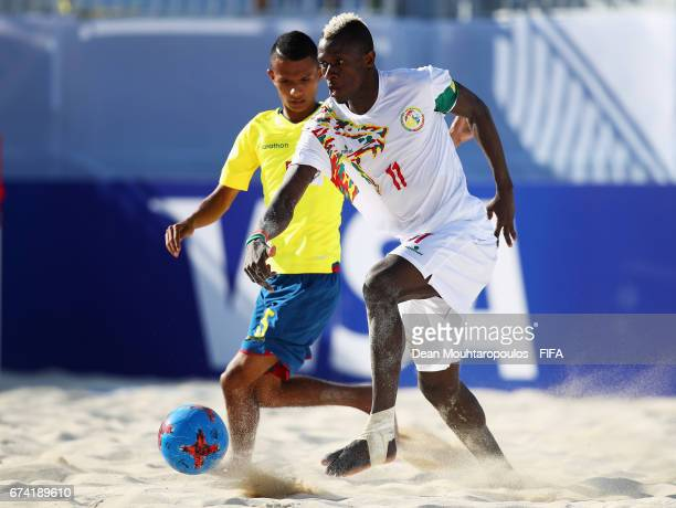 Jose Vera of Ecuador battles for the ball with Ibrahima Balde of Senegal during the FIFA Beach Soccer World Cup Bahamas 2017 group A match between...