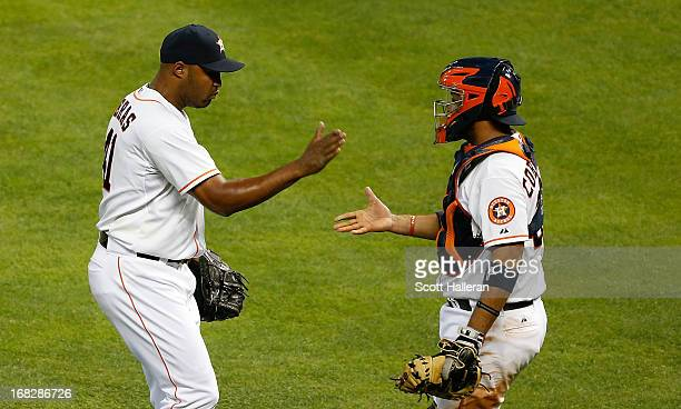 Jose Veras celebrates with his catcher Carlos Corporan after the Houston Astros defeated the Los Angeles Angels of Anaheim 76 at Minute Maid Park on...