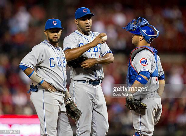 Jose Veras of the Chicago Cubs talks with Welington Castillo on the mound in the eighth inning during a game against the St Louis Cardinals at Busch...