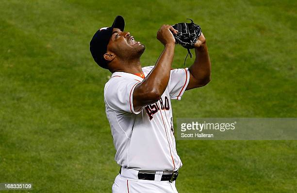 Jose Veras of the Houston Astros celebrates getting a save in the ninth inning during a 31 victory over the Los Angeles Angels of Anaheim at Minute...