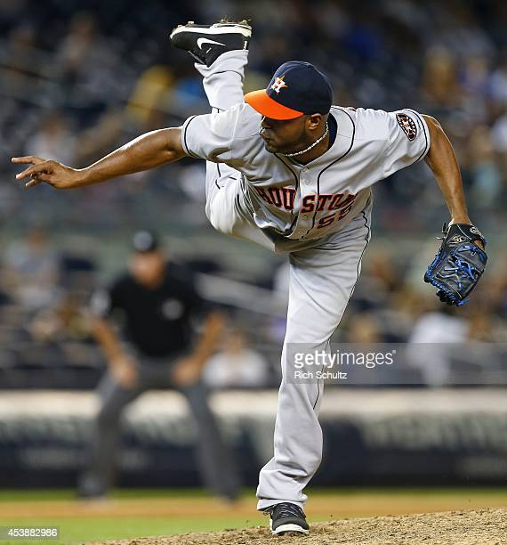 Jose Veras of the Houston Astros delivers a pitch against the New York Yankees during the ninth inning of a MLB baseball game at Yankee Stadium on...