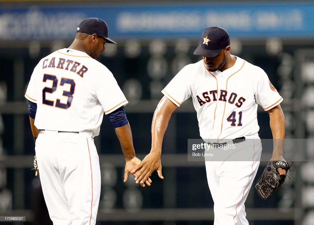 Jose Veras #41 of the Houston Astros taps hands with Chris Carter #23 of the Houston Astros after the final out as the Houston Astros defeated the Tampa Bay Rays 4-1 at Minute Maid Park on July 3, 2013 in Houston, Texas.