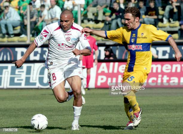 Jose Vidigal of Livorno and Francesco Parravicini of Parma compete for the ball during the Serie A match between Parma and Livorno at the Stadio...
