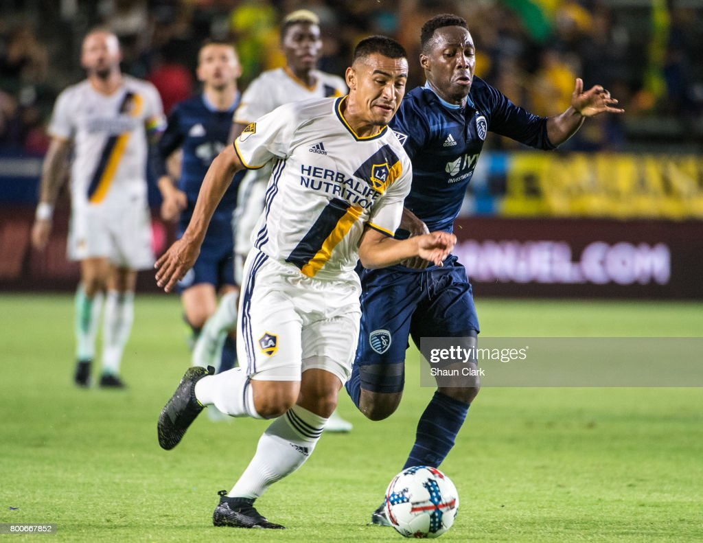 Jose Villarreal #33 of Los Angeles Galaxy races toward goal as Gerso #7 of Sporting Kansas City defends during the Los Angeles Galaxy's MLS match against Sporting KC at the StubHub Center on June 24, 2017 in Carson, California. Sporting Kansas City won the match 2-1