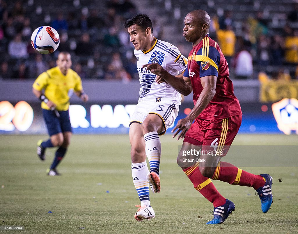 Jose Villarreal (5) of Los Angeles Galaxy traps the ball as Jamison Olave (4) of Real Salt Lake defends during Los Angeles Galaxy's match against Real Salt Lake at the Stubhub Center on May 27, 2015 in Carson, California. The LA Galaxy won the match 1-0.