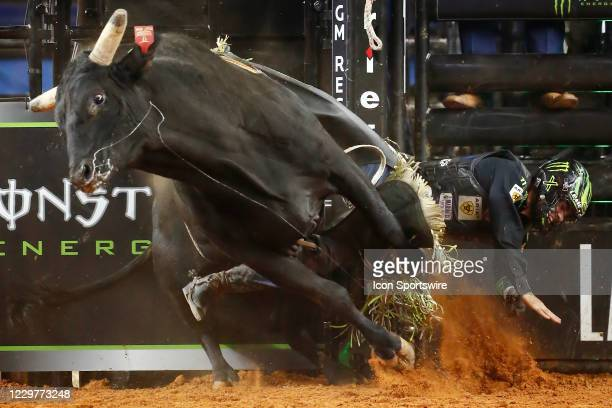 Jose Vitor Leme gets bucked from bull Night Hawk during the PBR World Finals, on November 15th at the AT&T Stadium, Arlington, TX.