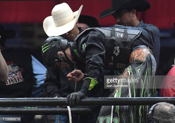 Jose Vitor Leme gets ready to ride the bull Preacher's Kid during the final round of the Professional Bullriders Mason Lowe Memorial on February 16...