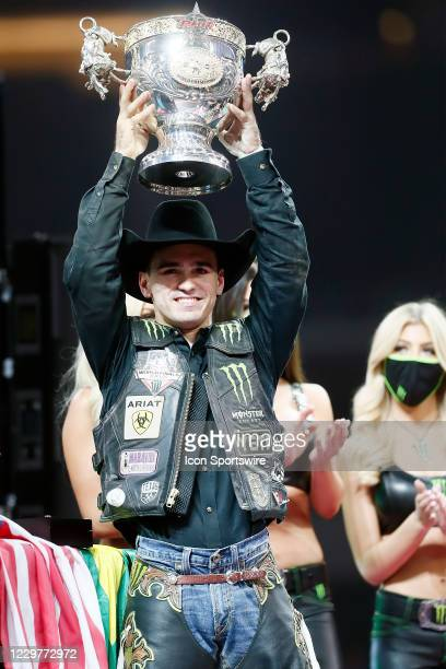 Jose Vitor Leme holds the World Champion trophy during the PBR World Finals, on November 15th at the AT&T Stadium, Arlington, TX.