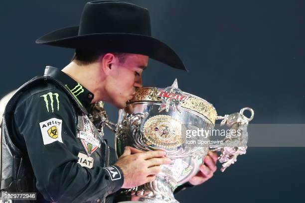 Jose Vitor Leme kisses the World Champion trophy during the PBR World Finals, on November 15th at the AT&T Stadium, Arlington, TX.