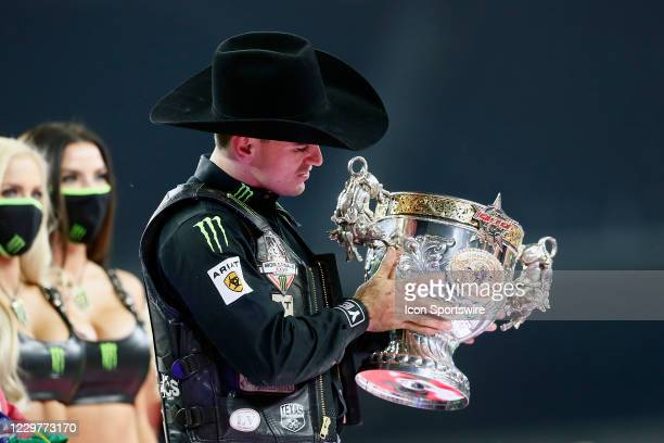 Jose Vitor Leme looks at the World Champion trophy during the PBR World Finals, on November 15th at the AT&T Stadium, Arlington, TX.