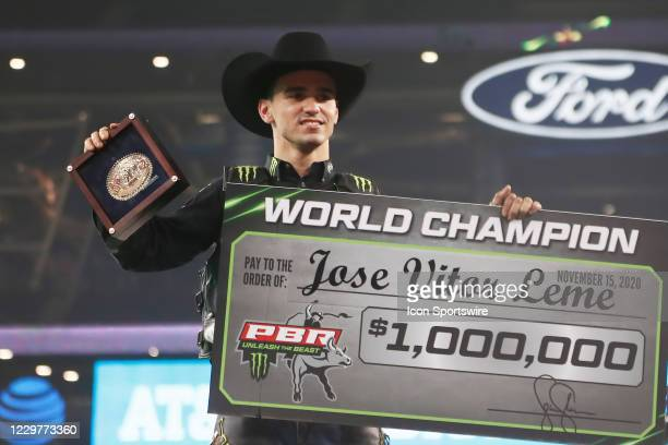 Jose Vitor Leme poses with the World Champion belt buckle and the World Champion check during the PBR World Finals, on November 15th at the AT&T...