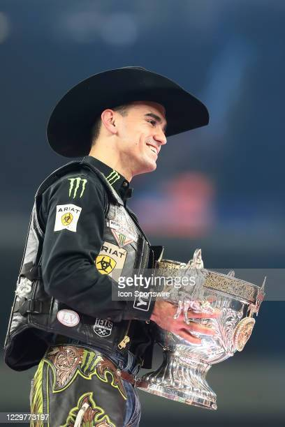 Jose Vitor Leme poses with the World Champion trophy during the PBR World Finals, on November 15th at the AT&T Stadium, Arlington, TX.
