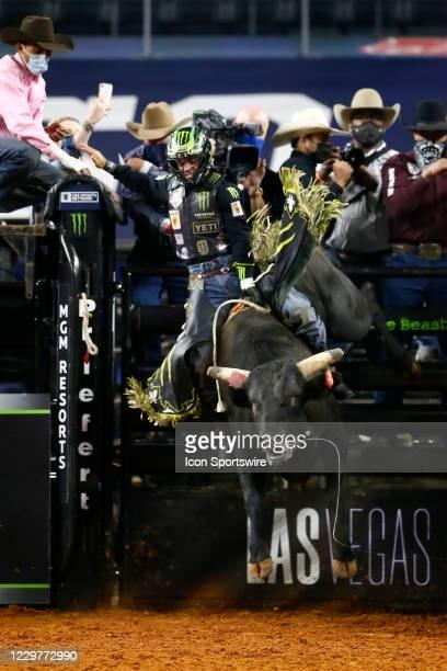 Jose Vitor Leme rides bull Night Hawk during the PBR World Finals, on November 15th at the AT&T Stadium, Arlington, TX.