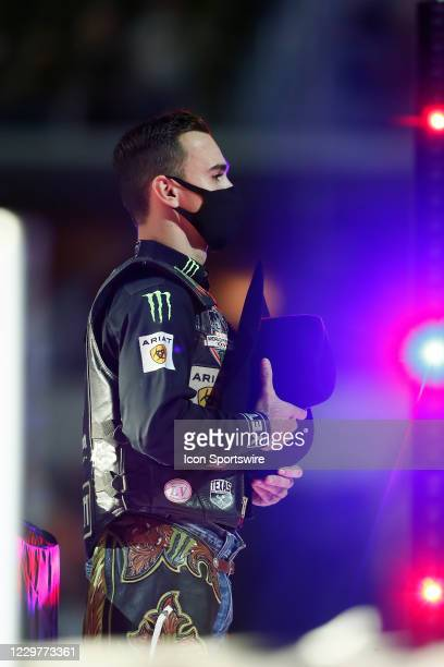 Jose Vitor Leme stands during the national anthem during the PBR World Finals, on November 15th at the AT&T Stadium, Arlington, TX.