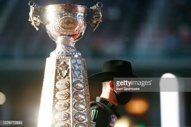 Jose Vitor Leme stands next to the PBR World Champion trophy during the PBR World Finals, on November 15th at the AT&T Stadium, Arlington, TX.