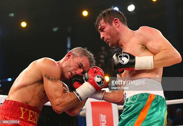 Jose Yebes of Spain exchange punches with Matthew Macklin of Great Britain during the middleweight fight at Sparkassen Arena on September 27 2014 in...