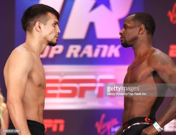 Jose Zepeda and Hank Lundy face-off during the weigh-in at Virgin Hotels Las Vegas on May 21, 2021 in Las Vegas, Nevada.