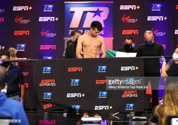 Jose Zepeda poses on the scale ahead of his fight with Hank Lundy at Virgin Hotels Las Vegas on May 21, 2021 in Las Vegas, Nevada.