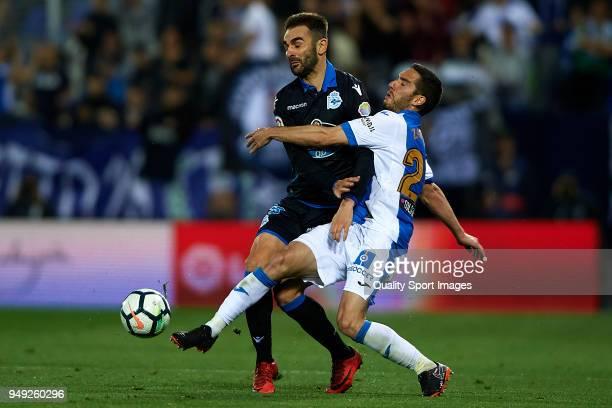 Joseba Zaldua of Leganes competes for the ball with Adrian Lopez of Deportivo La Coruna during the La Liga match between Leganes and Deportivo La...