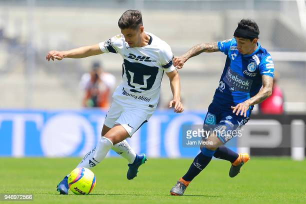 Josecarlos Van Rankin of Pumas and Omar Fernandez of Puebla fight for the ball during the 15th round match between Pumas UNAM and Puebla as part of...