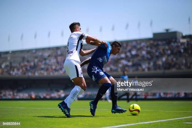 Josecarlos Van Rankin of Pumas struggles for the ball against Erik Pimentel of Puebla during the 15th round match between Pumas UNAM and Puebla as...