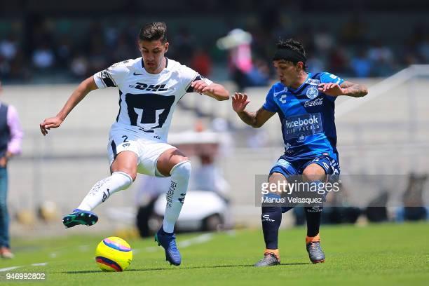 Josecarlos Van Rankin of Pumas struggles for the ball against Omar Fernandez of Puebla during the 15th round match between Pumas UNAM and Puebla as...
