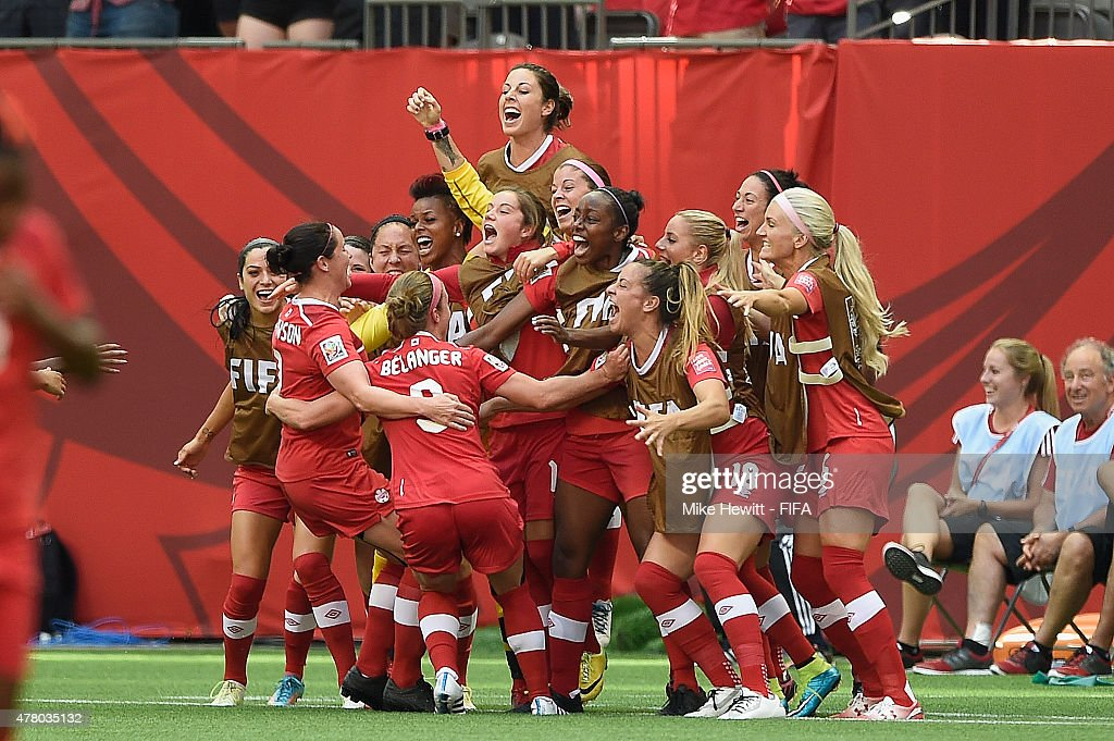 Josee Belanger of Canada celebrates with team mates after scoring during the FIFA Women's World Cup 2015 Round of 16 match between Canada and Switzerland at BC Place Stadium on June 21, 2015 in Vancouver, Canada.