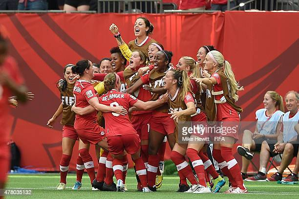 Josee Belanger of Canada celebrates with team mates after scoring during the FIFA Women's World Cup 2015 Round of 16 match between Canada and...