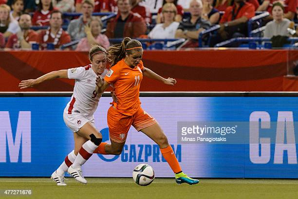 Josee Belanger of Canada challenges Lieke Martens of the Netherlands during the 2015 FIFA Women's World Cup Group A match at Olympic Stadium on June...
