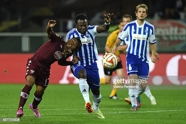 Josef Alexander Martinez of Torino FC competes with Gideon Baah of HJK Helsinki during the UEFA Europa League group B match between Torino FC and HJK...
